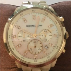 Round gold michael kors chronograph watch